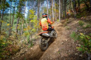 dirtbike rider on a steep uphill