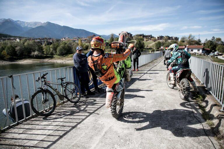 Enduro rider doing a wheelie on a bridge Enduro-ride Bulgaria Enduro Tours Bulgaria Teodor Kabakchiev KTM