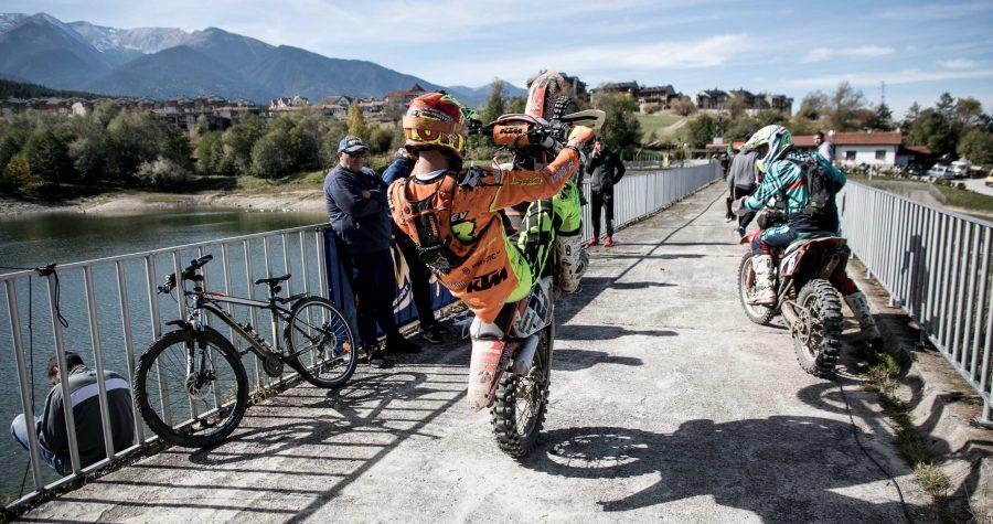 Enduro rider doing a wheelie on a bridge Enduro-ride Bulgaria Enduro Tours Bulgaria Teodor Kabakchiev KTM