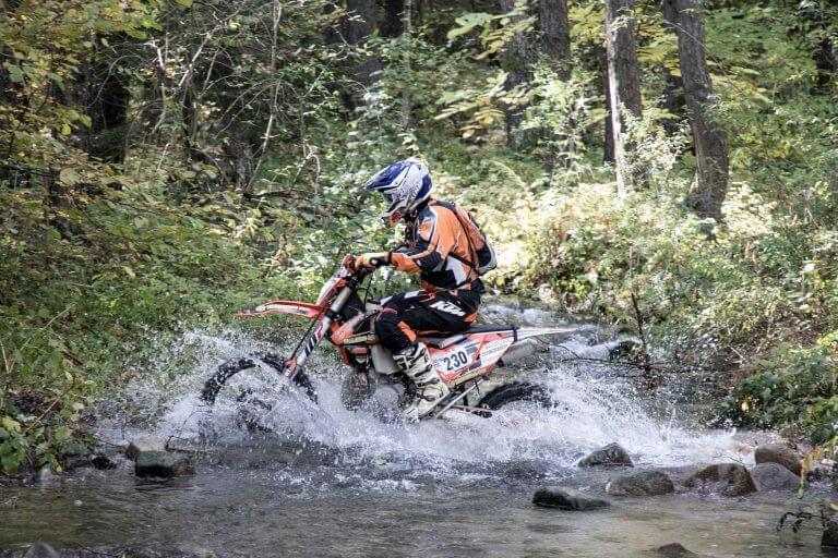 enduro rider crossing a river