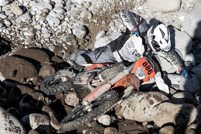 enduro rider crash on the rocks