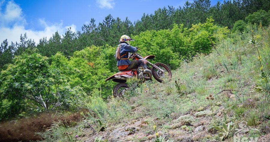 enduro rider full gas on a grassy uphill ENDURO TOURS BULGARIA