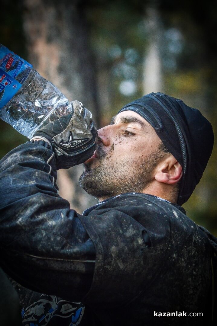 dirty enduro rider drinking water