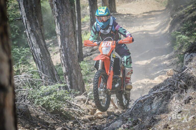 enduro rider wheeling in the forest ENDURO TOURS BULGARIA
