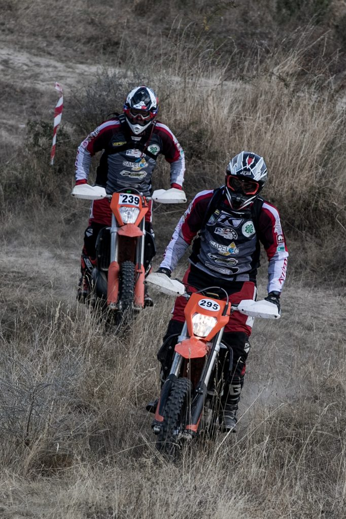 two guys riding enduro bikes