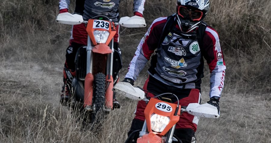 two guys riding enduro bikes